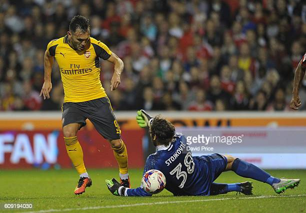 Lucas Perez beats Vladimir Stojkovic of Nottigham Forest to score Arsenal's 3rd goal his 2nd during the match between Nottingham Forest and Arsenal...