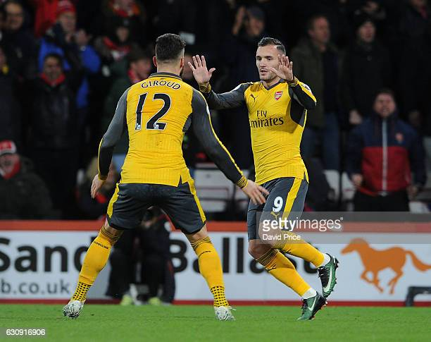 Lucas Perez celebrates scoring Arsenal's 2nd goal with Olivier Giroud during the Premier League match between AFC Bournemouth and Arsenal at Vitality...