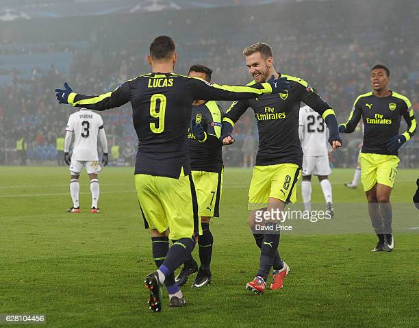 Lucas Perez celebrates scoring his and Arsenal's 3rd goal with Aaron Ramsey during the UEFA Champions League match between FC Basel and Arsenal at St...