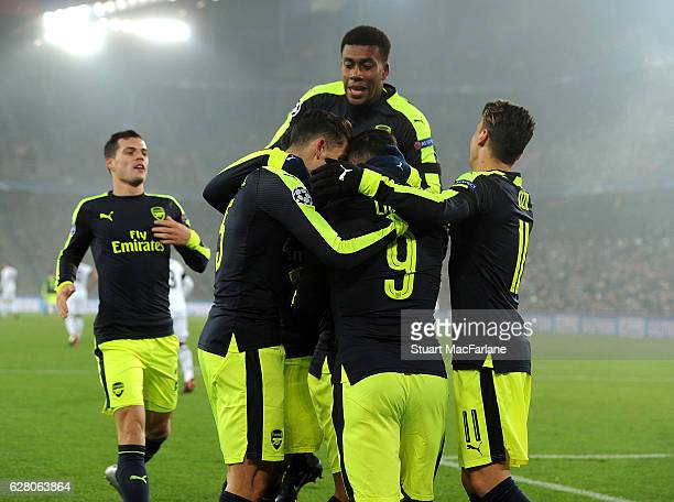 Lucas Perez celebrates scoring the 1st Arsenal goal with Gabriel Alex Iwobi and Mesut Ozil during the UEFA Champions League match between FC Basel...