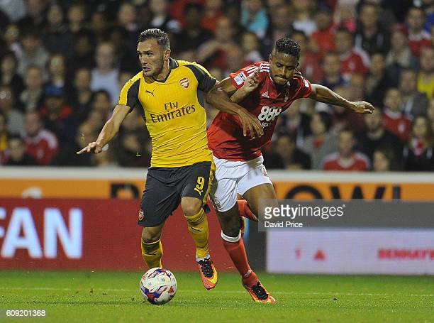 Lucas Perez holds off Michael Mancienne of Nottigham Forest to score Arsenal's 3rd goal his 2nd during the match between Nottingham Forest and...