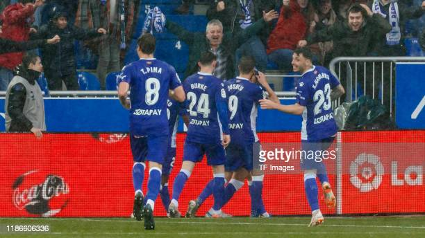 Lucas Perez of Alaves celebrates his goal with team mates during the Liga match between Deportivo Alaves and Real Madrid CF at Estadio de...