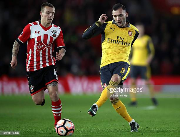 Lucas Perez of Arsenal and Jordy Clasie of Southampton in action during the Emirates FA Cup Fourth Round match between Southampton and Arsenal at St...