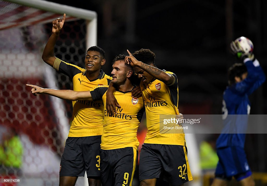 Lucas Perez (C) of Arsenal celebrates scoring his team's third goal with Jeff Reine-Adelaide (L) and Chuba Akpom of Arsenal during the EFL Cup Third Round match between Nottingham Forest and Arsenal at City Ground on September 20, 2016 in Nottingham, England.