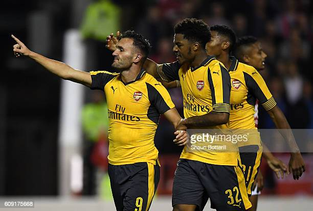 Lucas Perez of Arsenal celebrates scoring his team's third goal with Chuba Akpom of Arsenal during the EFL Cup Third Round match between Nottingham...