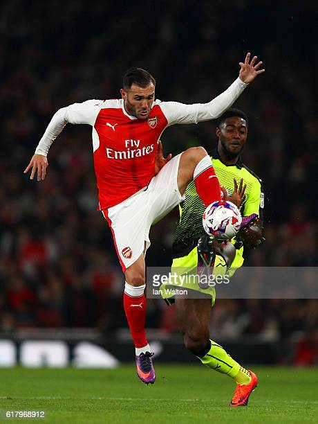Lucas Perez of Arsenal controls the ball in mid air while under pressure from Tyler Blackett of Reading during the EFL Cup fourth round match between...