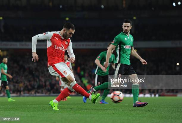 Lucas Perez of Arsenal crosses under pressure form Sam Habergham of Lincoln during the match between Arsenal and Lincoln City at Emirates Stadium on...