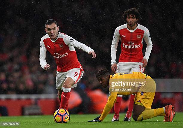 Lucas Perez of Arsenal goes past Wilfried Zaha of Crystal Palace during the Premier League match between Arsenal and Crystal Palace at the Emirates...