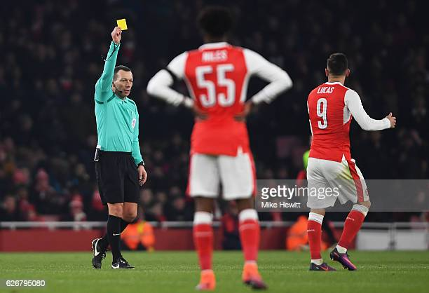 Lucas Perez of Arsenal is shown a yellow card by referee Kevin Friend during the EFL Cup quarter final match between Arsenal and Southampton at the...