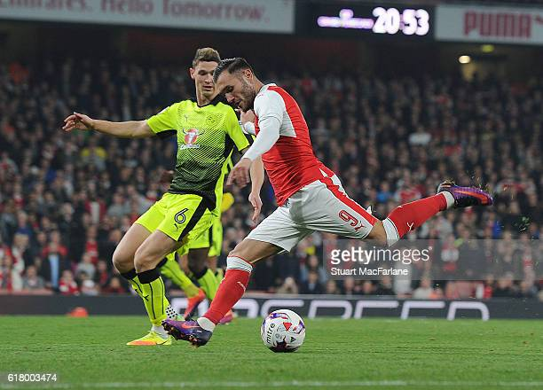 Lucas Perez of Arsenal takes on George Evans of Reading during the EFL Cup Fourth Round match between Arsenal and Reading at Emirates Stadium on...