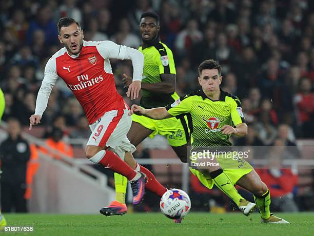 Lucas Perez of Arsenal takes on Liam Kelly of Reading during the match between Arsenal and Reading at Emirates Stadium on October 25 2016 in London...