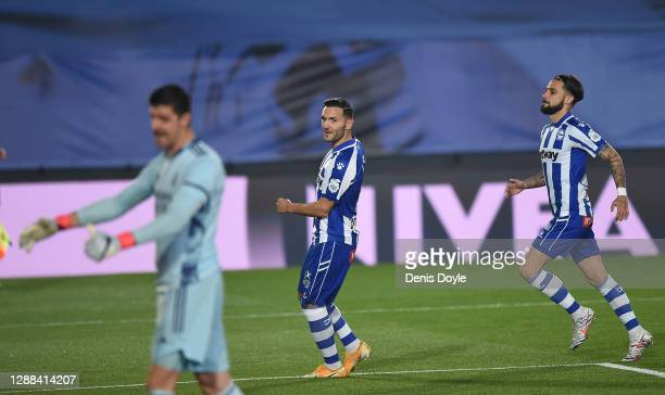 Lucas Perez of Deportivo Alaves celebrates after scoring a penalty for his team's first goal during the La Liga Santander match between Real Madrid...