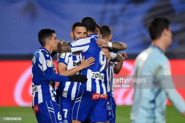 Lucas Perez of Deportivo Alaves celebrates with teammates Rodrigo Battaglia and Joselu after scoring his team's first goal during the La Liga...