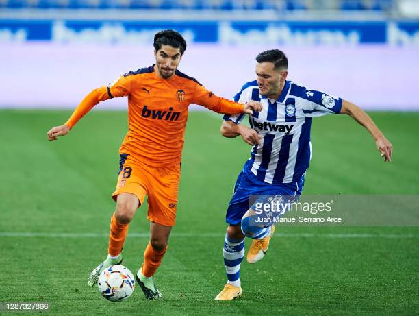 Lucas Perez of Deportivo Alaves duels for the ball with Carlos Soler of Valencia CF during the LaLiga Santander match between Alaves and Valencia on...