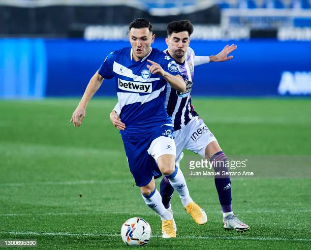 Lucas Perez of Deportivo Alaves duels for the ball with Kike Perez of Real Valladolid CF during the La Liga Santander match between Deportivo Alavés...
