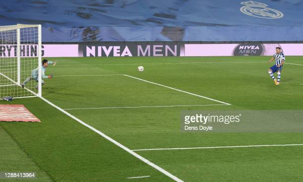 Lucas Perez of Deportivo Alaves scores a penalty for his team's first goal past Thibaut Courtois of Real Madrid during the La Liga Santander match...