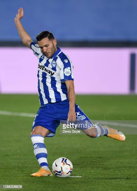 Lucas Perez of Deportivo Alaves scores their team's first goal from the penalty spot during the La Liga Santander match between Real Madrid and...