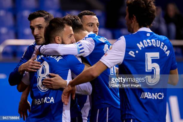 Lucas Perez of Deportivo de La Coruna celebrates with his teammates after scoring his team's first goal during the La Liga match between Deportivo La...