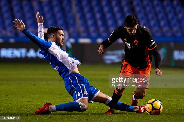 Lucas Perez of Deportivo de La Coruna competes for the ball with Gonçalo Guedes of Valencia CF during the La Liga match between Deportivo La Coruna...