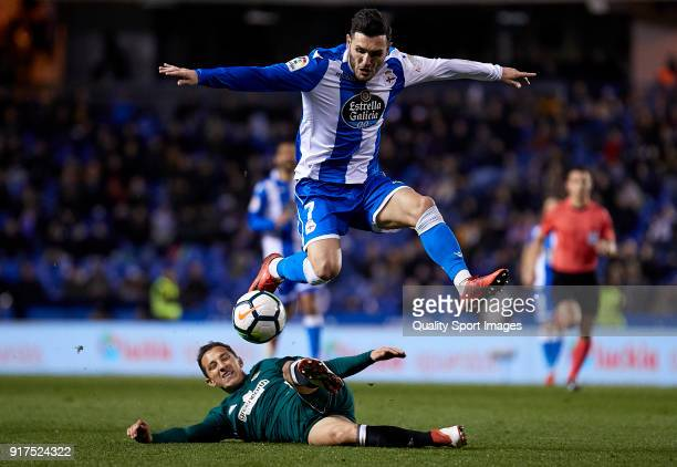 Lucas Perez of Deportivo de La Coruna is tackled by Andres Guardado of Real Betis during the La Liga match between Deportivo La Coruna and Real Betis...