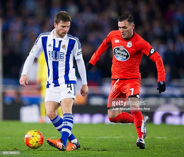 Lucas Perez of Deportivo La Coruna duels for the ball with Asier Illarramendi of Real Sociedad during the La Liga match between Real Sociedad de...