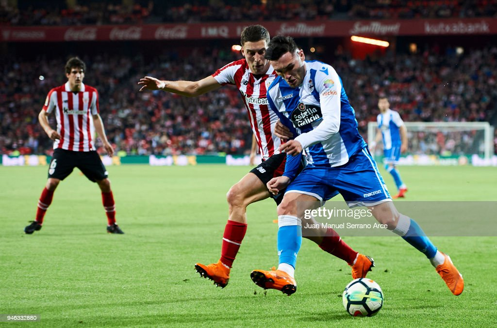 Lucas Perez of RC Deportivo La Coruna competes for the ball with Oscar De Marcos of Athletic Club during the La Liga match between Athletic Club Bilbao and RC Deportivo La Coruna at San Mames Stadium on April 14, 2018 in Bilbao, Spain.
