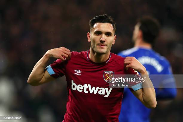 Lucas Perez of West Ham United celebrates after scoring his team's second goal during the Premier League match between West Ham United and Cardiff...