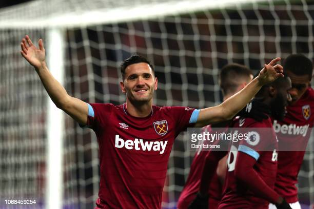 Lucas Perez of West Ham United celebrates after scoring his team's first goal during the Premier League match between West Ham United and Cardiff...