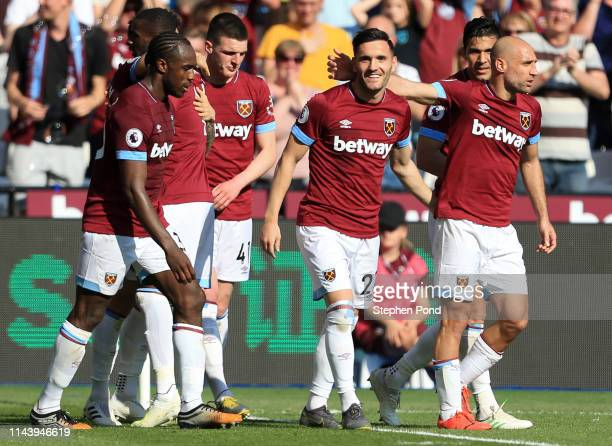 Lucas Perez of West Ham United celebrates with team mates after scoring their team's second goal during the Premier League match between West Ham...