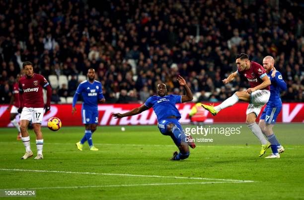 Lucas Perez of West Ham United scores his team's first goal during the Premier League match between West Ham United and Cardiff City at London...