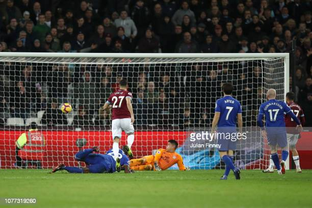 Lucas Perez of West Ham United shoots and scores his team's first goal during the Premier League match between West Ham United and Cardiff City at...