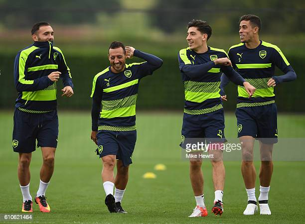 Lucas Perez Santi Cazorla Hector Bellerin and Gabriel of Arsenal warm up during an Arsenal training session ahead of the Champions League Group A...
