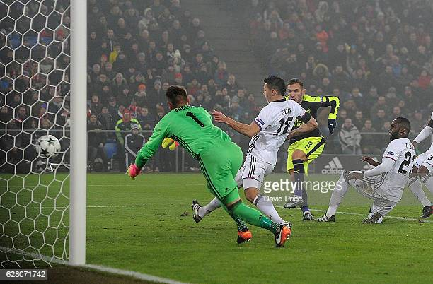 Lucas Perez scores his and Arsenal's 2nd goal past Tomas Vaclik of Basel during the UEFA Champions League match between FC Basel and Arsenal at St...