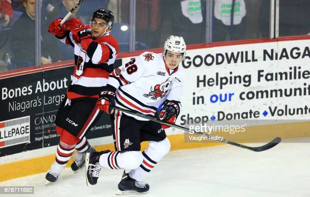 Lucas Peric of the Ottawa 67's and Andrew Bruder of the Niagara IceDogs battle for the puck during the first period of an OHL game at the Meridian...