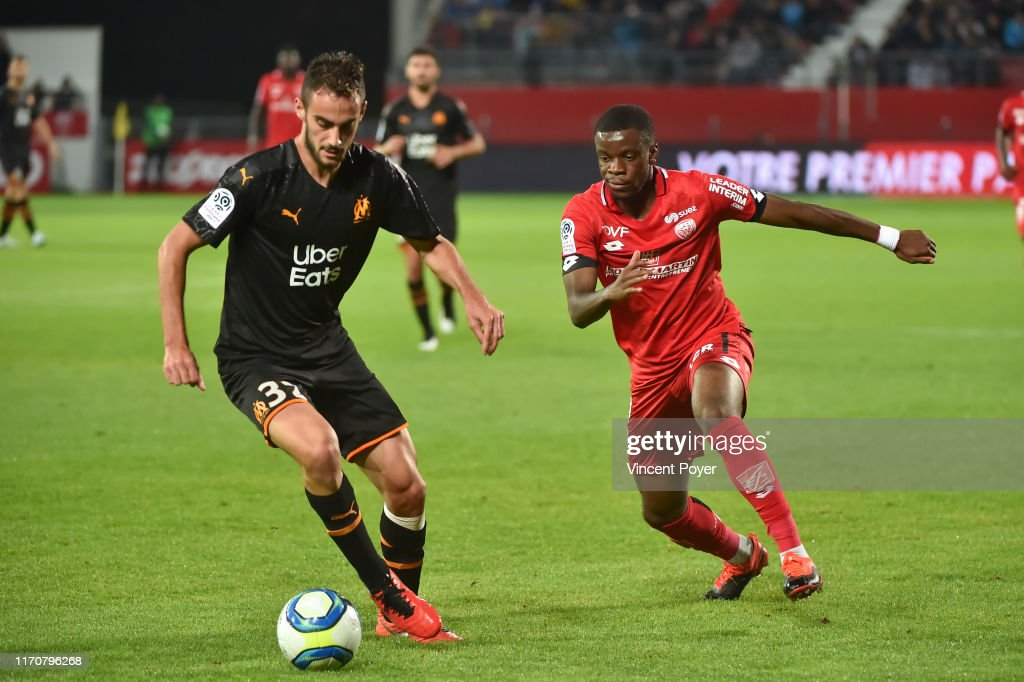 Lucas Perrin Of Om And Stephy Mavididi Of Dfco During The Ligue 1 News Photo Getty Images