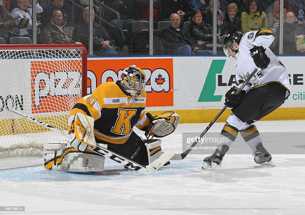Lucas Perssini #40 of the Kingston Frontenacs stops a shoot-out attempt by Mitchell Marner #93 of the London Knights in an OHL game at Budweiser Gardens on November 29, 2014 in London, Ontario, Canada. The Frontenacs defeated the Knights 3-2 in an overtime shoot-out.