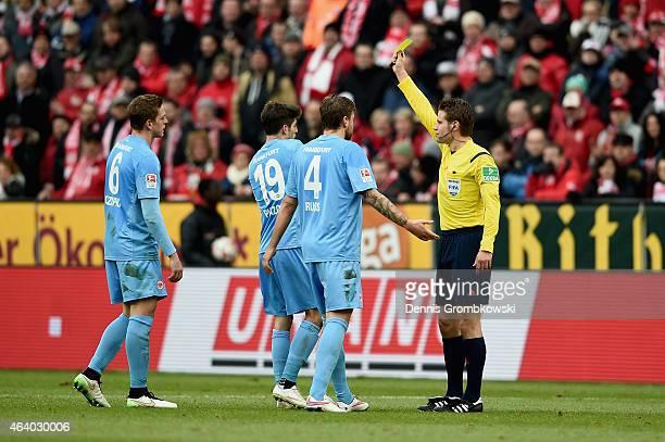 Lucas Piazon of Eintracht Frankfurt is shown the yellow card by referee Felix Brych during the Bundesliga match between 1 FSV Mainz 05 and Eintracht...