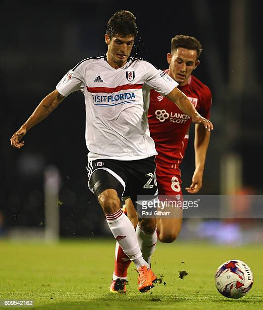 Lucas Piazon of Fulham and Josh Brownhill of Bristol City in action during the EFL Cup Third Round match between Fulham and Bristol City at Craven...
