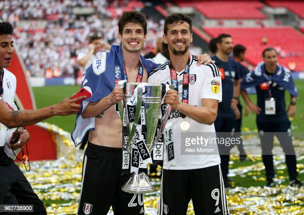 Lucas Piazon of Fulham and Rui Fonte of Fulham celebrate with the trophy following their sides victory in the Sky Bet Championship Play Off Final...