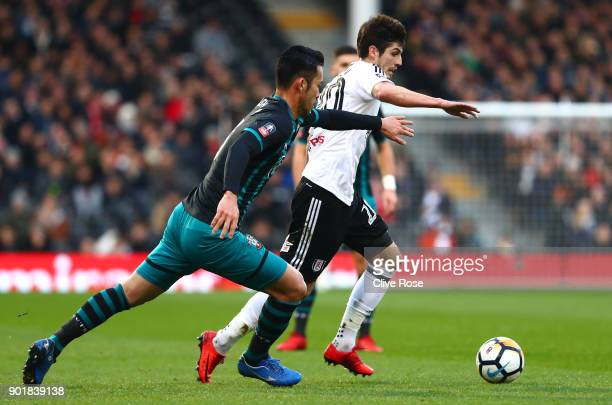 Lucas Piazon of Fulham is challenged by Maya Yoshida of Southampton during The Emirates FA Cup Third Round match between Fulham and Southampton at...