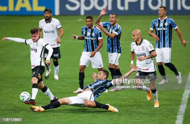 Lucas Piton of Corinthians and Diego Souza of Gremio fight for the ball during the match as part of Brasileirao Series A 2020 at Neo Quimica Arena on...