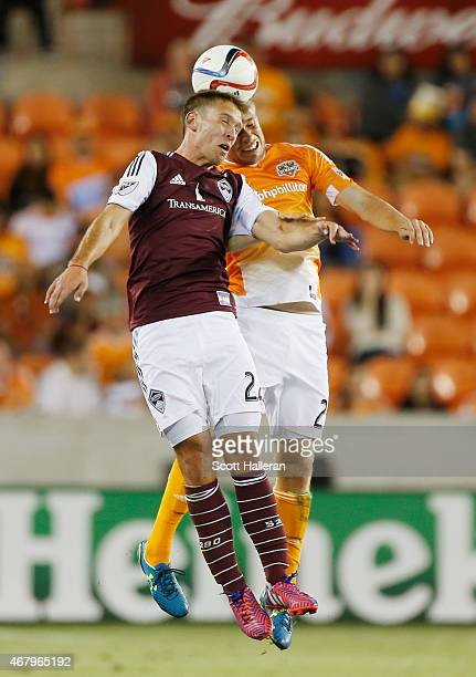 Lucas Pittinari of the Colorado Rapids battles for the ball with Zach Steinberger of the Houston Dynamo during their game at BBVA Compass Stadium on...