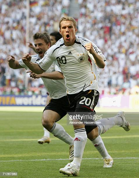 Lucas Podolski of Germany celebrates after scoring the opening goal during the FIFA World Cup Germany 2006 Round of 16 match between Germany and...