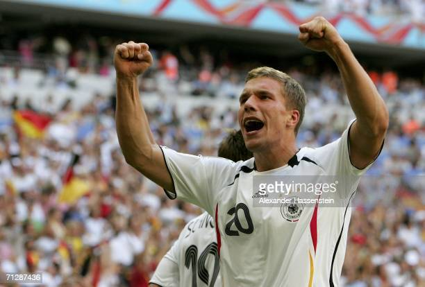 Lucas Podolski of Germany celebrates, after scoring the opening goal during the FIFA World Cup Germany 2006 Round of 16 match between Germany and...