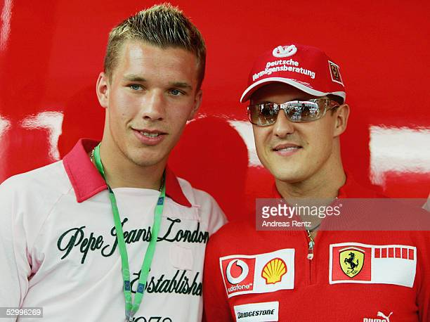 Lucas Podolski, soccer player of 1.FC Cologne, and Michael Schumacher pose during the European F1 Grand Prix at the Nurburgring on May 29, 2005 in...