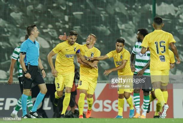 Lucas Possignolo of Portimonense SC celebrates with teammates after scoring a goal during the Friendly match between Portimonense SC and Sporting CP...