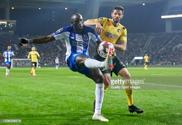 Lucas Possignolo of Portimonense SC competes for the ball with Moussa Marega of FC Porto during the Liga Nos match between FC Porto and Portimonense...