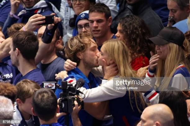 Lucas Pouille and his girlfriend Clemence Bertrand celebrate after winning the Davis Cup Final during day 3 of the Davis Cup World Group final...