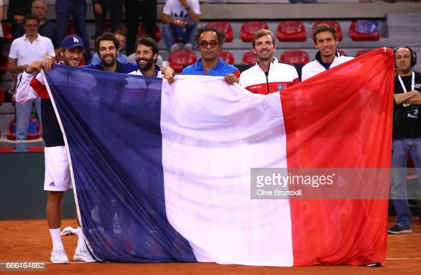Lucas Pouille, Jeremy Chardy, Jonathan Eysseric, captain Yannick Noah, Julien Benneteau and Nicolas Mahut of France celebrate their victory against...