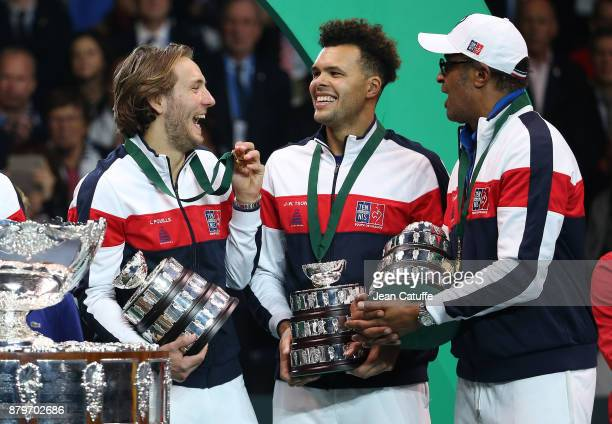 Lucas Pouille, Jo-Wilfried Tsonga, captain of France Yannick Noah celebrate winning the Davis Cup during the trophy presentation on day 3 of the...